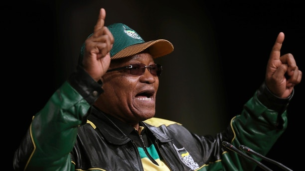 FILE -- In this June 30, 2017 file photo South Africa's ruling African National Congress (ANC) party leader, President Jacob Zuma, gestures as he addresses party delegates, during the ANC policy conference in Johannesburg, South Africa. South Africa's parliament is preparing to vote on a motion of no confidence in embattled South African President Jacob Zuma. If the motion succeeds, he must resign. (AP Photo/Themba Hadebe, File)