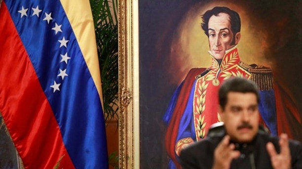A painting of South American independence leader Simon Bolivar is seen as Venezuela's President Nicolas Maduro talks to the media during a news conference at Miraflores Palace in Caracas, Venezuela June 22, 2017. REUTERS/Marco Bello - RTS189EK