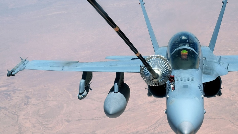 A F-18 Super Hornet receives fuel.