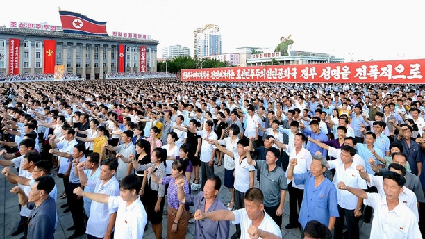 People participate in a Pyongyang city mass rally held at Kim Il Sung Square on August 9, 2017, to fully support the statement of the Democratic People's Republic of Korea (DPRK) government in this photo released on August 10, 2017 by North Korea's Korean Central News Agency (KCNA) in Pyongyang. KCNA/via REUTERS ATTENTION EDITORS - THIS IMAGE WAS PROVIDED BY A THIRD PARTY. REUTERS IS UNABLE TO INDEPENDENTLY VERIFY THIS IMAGE. NO THIRD PARTY SALES. SOUTH KOREA OUT. NO COMMERCIAL OR EDITORIAL SALES IN SOUTH KOREA.? - RTS1B4MA