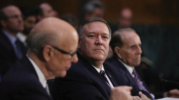 Sen. Pat Roberts, R-Kan. left, introduces CIA Director-designate Rep. Mike Pompeo, R-Kan., center, on Capitol Hill in Washington, Thursday, Jan. 12, 2017, during Pompeo's confirmation hearing before the Senate Intelligence Committee. At right is former Senate Majority Leader Bob Dole.  (AP Photo/Manuel Balce Ceneta)