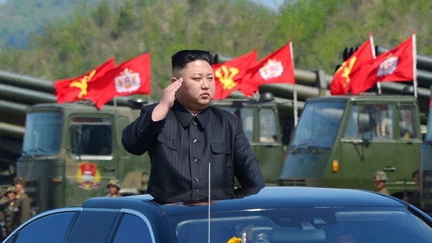 North Korea's leader Kim Jong Un watches a military drill marking the 85th anniversary of the establishment of the Korean People's Army (KPA) in this handout photo by North Korea's Korean Central News Agency (KCNA) made available on April 26, 2017. KCNA/Handout via REUTERS      ATTENTION EDITORS - THIS IMAGE WAS PROVIDED BY A THIRD PARTY. EDITORIAL USE ONLY. REUTERS IS UNABLE TO INDEPENDENTLY VERIFY THIS IMAGE. NO THIRD PARTY SALES. SOUTH KOREA OUT. - RTS13Y8S