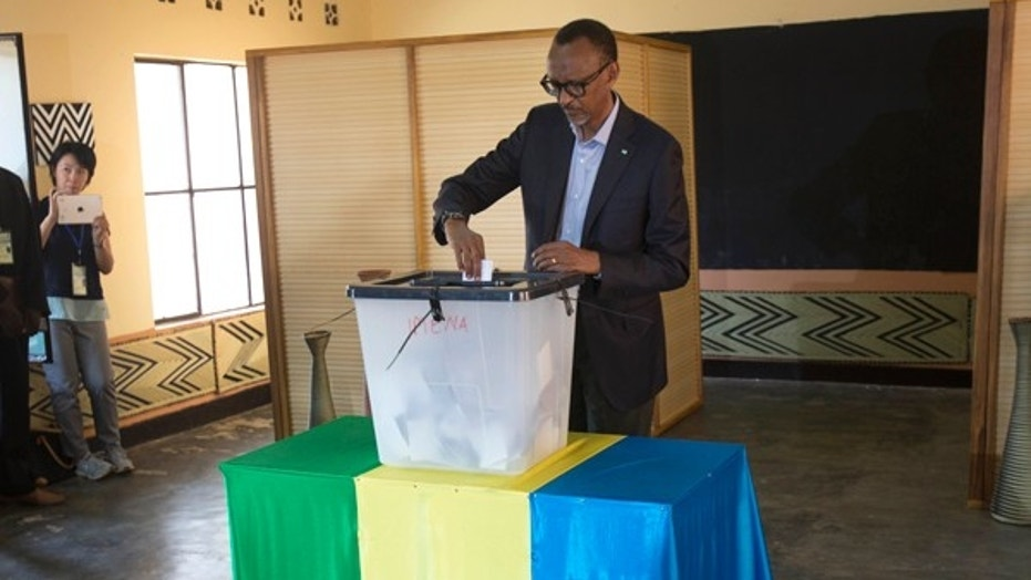 Rwandan President Paul Kagame casts his ballot in Kigali, Aug. 4, 2017. Kagame won another term after the government disqualified all but three candidates.
