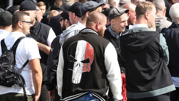 Far-right extremists gather to commemorate the death of Adolf Hitler's deputy, Rudolf Hess, in Berlin's western district  of Spandau, Saturday, Aug. 19, 2017.  Police are allowing the march, but participants are not allowed to glorify Hess, who died at Spandau prison 30 years ago. A counter demonstration is also expected.  (Maurizio Gambarini/dpa via AP)
