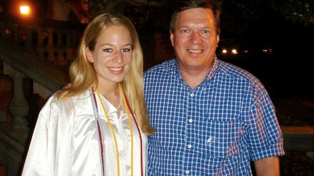 In this handout photo provided by Beth Twitty, Natalee Holloway, 18, left stands with her father Dave Holloway on her graduation day from Mountain Brook High School in Mountain Brook, Alabama, Tuesday, May 24, 2005.  Holloway disappeared while on a graduation trip to Aruba on May 30.  (AP Photo/Courtesy of Beth Twitty, HO)