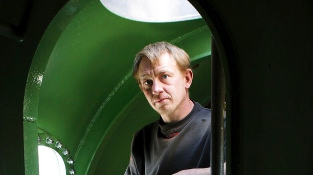 """FILE -  This is a April 30 2008 file photo of  submarine owner Peter Madsenstands inside the vessel . Denmark's navy says that Madsen's  privately built submarine that had been feared missing in Danish waters has been found and the crew is safe. The navy says that the 40-ton, nearly 18-meter-long (60-foot-long) submarine with at least two people on board had been """"found sailing"""" south of Copenhagen. (Niels Hougaard /Ritzau. File via AP)"""