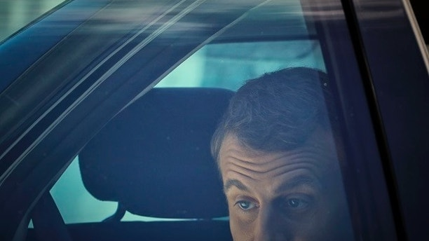 "French President Emmanuel Macron gets out of a car before the welcoming ceremony at the Cotroceni Presidential Palace in Bucharest, Romania, Thursday, Aug. 24, 2017. French President Emmanuel Macron arrived in Romania, the second leg of his trip to Central Europe where he will raise concerns over so-called ""posted workers"" — cheap labor from Eastern Europe posted temporarily to more prosperous European countries. (AP Photo/Vadim Ghirda)"