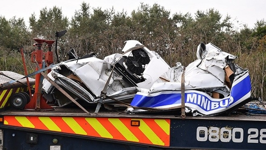 A crash involving two trucks and a minibus on a British highway killed at least eight people on Saturday, Aug. 26, 2017.