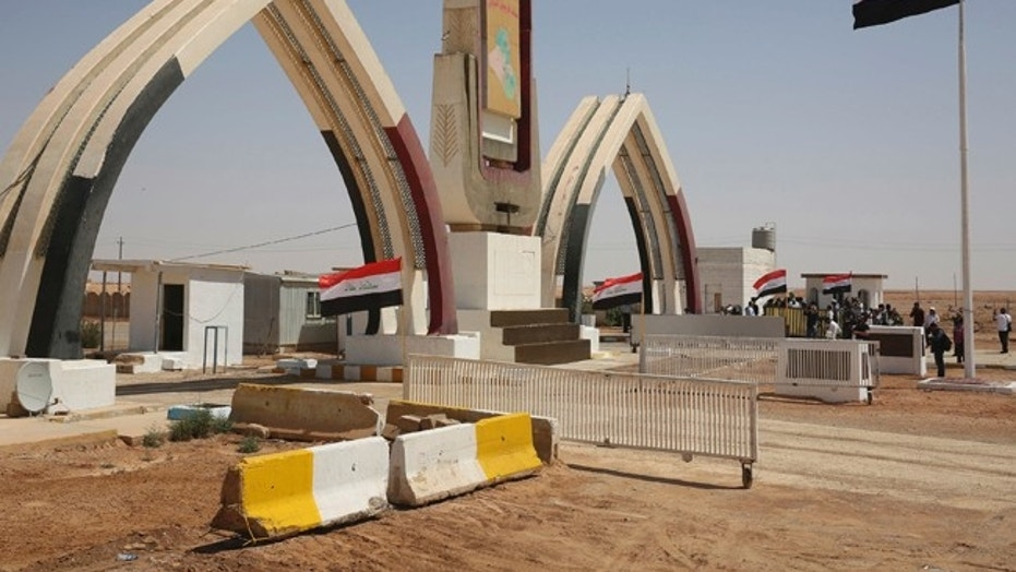Iraqi flags fly at the recently opened Iraqi Trebil border crossing on the Iraq-Jordan border on Aug. 30, 2017.