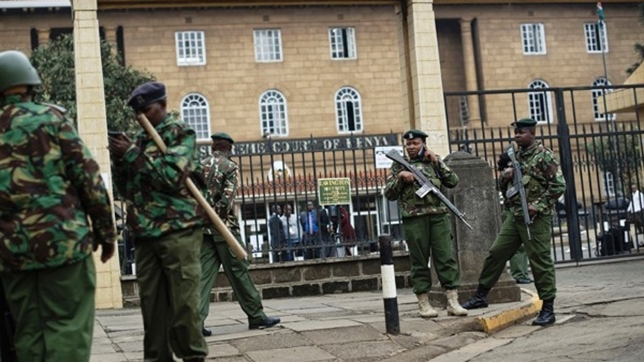 Police guard the Supreme Court building ahead of an expected verdict in the presidential election petition in downtown Nairobi, Kenya, Friday, Sept. 1, 2017. Kenya's Supreme Court ruled in favor of opposition leader Raila Odinga's challenge to President Uhuru Kenyatta's re-election earlier this month.