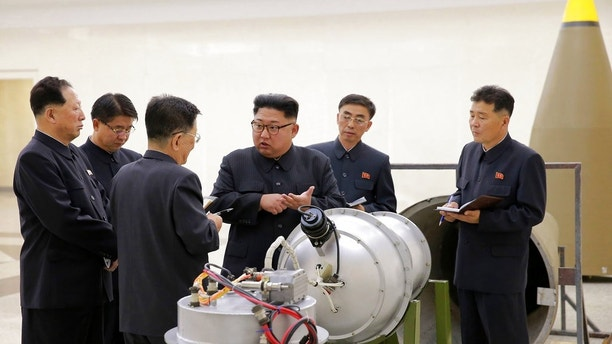 In this undated image distributed on Sunday, Sept. 3, 2017, by the North Korean government, shows North Korean leader Kim Jong Un at an undisclosed location. North Korea's state media on Sunday, Sept 3, 2017, said leader Kim Jong Un inspected the loading of a hydrogen bomb into a new intercontinental ballistic missile, a claim to technological mastery that some outside experts will doubt but that will raise already high worries on the Korean Peninsula. Independent journalists were not given access to cover the event depicted in this image distributed by the North Korean government. The content of this image is as provided and cannot be independently verified. (Korean Central News Agency/Korea News Service via AP)