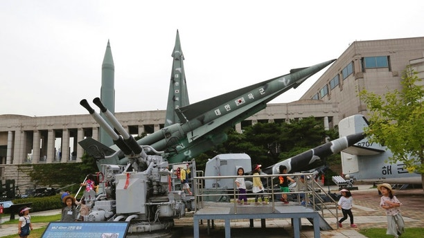 A mock North Korea's Scud-B missile, left top, and South Korean missiles are displayed at Korea War Memorial Museum in Seoul, South Korea, Tuesday, Sept. 5, 2017. South Korea's presidential office said on Tuesday Washington and Seoul have agreed to remove bilaterally agreed warhead restrictions on South Korean missiles, which would allow the South to develop more powerful weapons that would boost its pre-emptive strike capabilities against the North. (AP Photo/Ahn Young-joon)