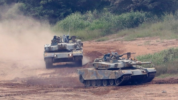 "South Korean army's K-1 tanks move during a military exercise in Paju, South Korea, Tuesday, Sept. 5, 2017. South Korean warships conducted live-fire exercises at sea Tuesday as Seoul continued its displays of military capability following U.S. warnings of a ""massive military response"" after North Korea detonated its largest-ever nuclear test explosion. (AP Photo/Lee Jin-man)"