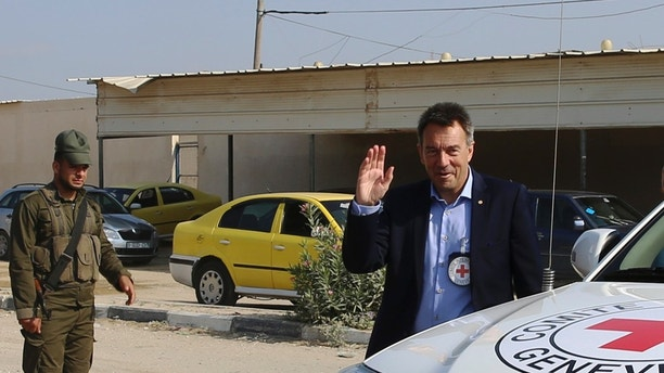 Peter Maurer, the president of the International Committee of the Red Cross (ICRC), waves upon his arrival at the Palestinian side of the Erez checkpoint in Beit Hanoun, northern Gaza Strip, Tuesday, Sept. 5, 2017. Maurer's in a three-day visit to the area, will meet with Israeli and Palestinian authorities including a meeting with Yehiyeh Sinwar, a top Hamas official in Gaza, and families of the Palestinian prisoners held at the Israeli jails. (AP Photo/Adel Hana)