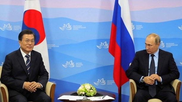 Japan, S.Korea push Putin over Pyongyang sanctions