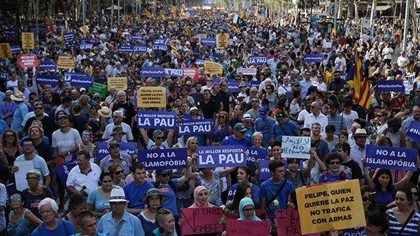 People gather for a march during the Catalan National Day in Barcelona, Spain, Monday Sept. 11, 2017. Hundreds of thousands are expected to rally in Barcelona to show support for an independent Catalan nation and the right to vote in a controversial referendum that has been banned by Spain. main banners read 'No to Islamophobia', Felipe (Gonzalez), no to arms traffic', ' The best answer is peace'. (AP Photo/Emilio Morenatti)