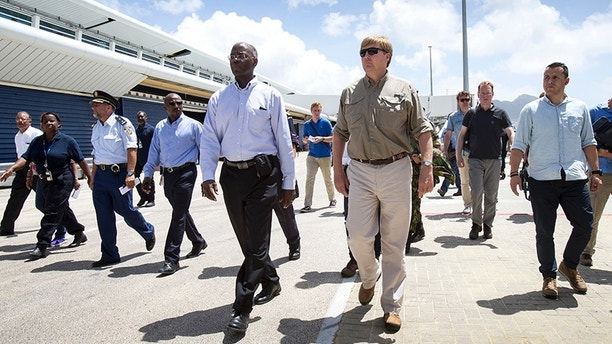 This photo provided by the Dutch Defense Ministry shows Dutch King Willem-Alexander, center right, visiting after the passing of Hurricane Irma, in Dutch Caribbean St. Maarten, on Monday Sept. 11, 2017. Dutch King Willem-Alexander said the scenes of devastation he witnessed on the Caribbean island of St. Martin in the aftermath of Hurricane Irma are the worst he has ever seen. (Gerben Van Es/Dutch Defense Ministry via AP)