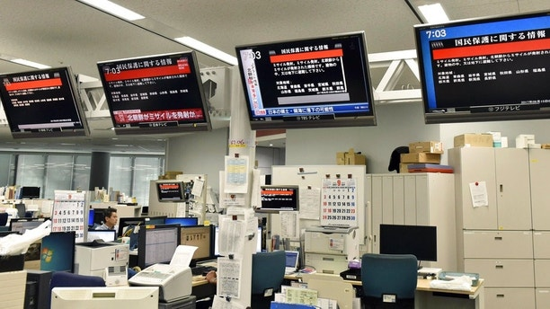 TV monitors show the J-Alert (warning siren) at an office of Kyodo News in Tokyo Friday, Sept. 15, 2017. South Korea's military said North Korea fired an unidentified missile Friday from its capital Pyongyang that flew over Japan before landing in the northern Pacific Ocean. (Toshiyuki Kuwana/Kyodo News via AP)