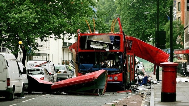 Debris is seen around a destroyed number 30 double-decker bus, after it was struck by a bomb, in Tavistock Square in central London in this July 8, 2005 file photograph. Al Qaeda leader Osama bin Laden was killed in a firefight with U.S. forces in Pakistan on May 1, 2011 ending a nearly 10-year worldwide hunt for the mastermind of the Sept. 11 attacks.