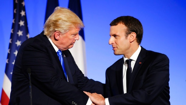 "U.S President Donald Trump, left, shakes hands with French President Emmanuel Macron after a press conference at the Elysee Palace in Paris, Thursday, July 13, 2017. President Donald Trump is saluting the United States' ""unbreakable"" bond with France. (AP Photo/Markus Schreiber)"