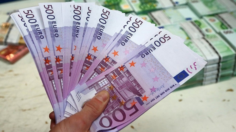 March 3, 2016: An employee holds 500 euro banknotes in the Money Service Austria company's headquarters in Vienna, Austria.