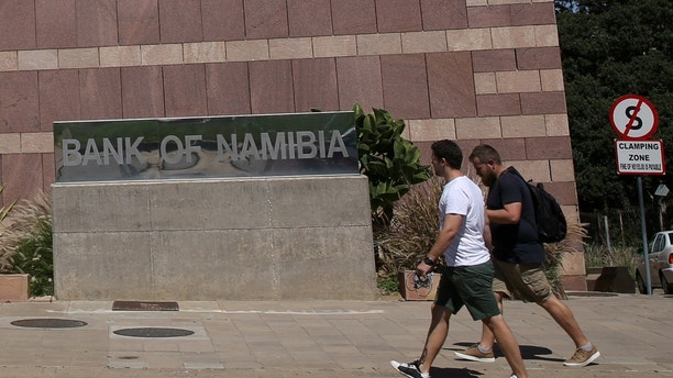 People walk past a logo of the Bank of Namibia at the company's headquarters in Windhoek, Namibia, February 24, 2017.  REUTERS/Siphiwe Sibeko - RC130A38D660