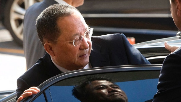 "FILE - In this Sept. 19, 2017, file photo, North Korean Foreign Minister Ri Yong Ho gets into a car at Beijing Capital International Airport in Beijing. Ri in New York on Wednesday, Sept. 20, 2017, described as ""the sound of a dog barking"" U.S President Donald Trump's threat to destroy his country. The comments are the North's first response to Trump's speech at the U.N. General Assembly. (AP Photo/Mark Schiefelbein, File)"