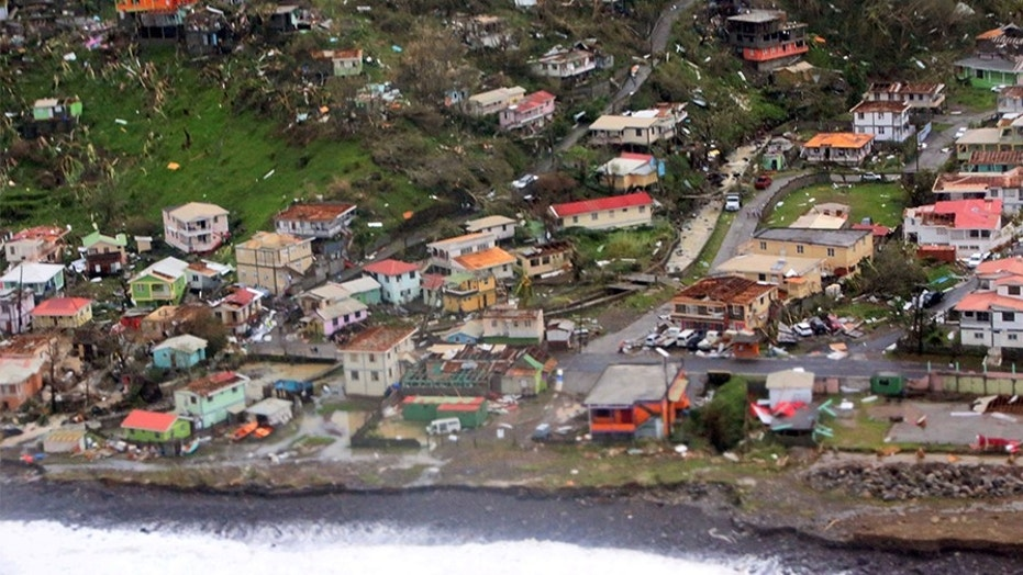 Damaged homes from Hurricane Maria are seen in an aerial photo taken over Dominica.