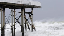 Support beams from a fishing pier lean onto others after breaking off from the platform as the effects Hurricane Jose hit Belmar, N.J., Tuesday, Sept. 19, 2017. Hurricane Jose turned up dangerous surf and rip currents along the U.S. East Coast while it moved north over the Atlantic Ocean. (AP Photo/Julio Cortez)
