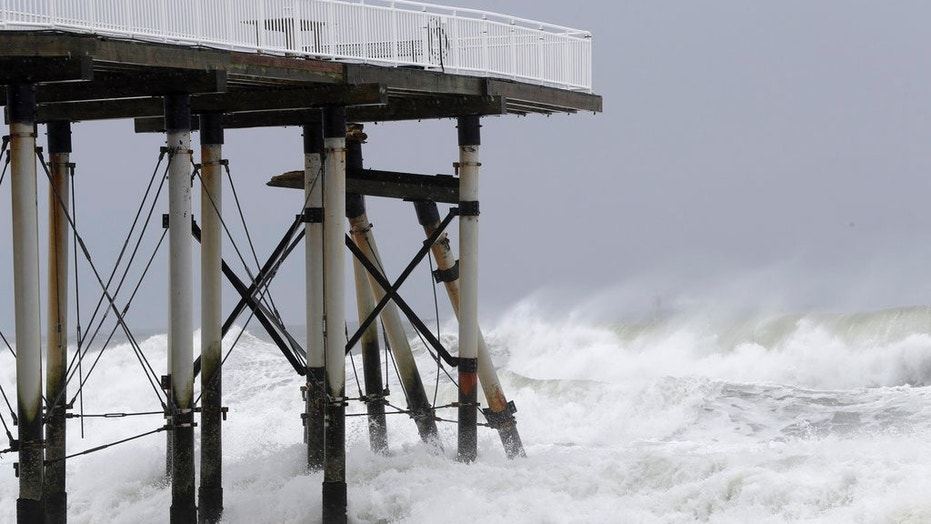 Support beams from a fishing pier lean onto others after breaking off from the platform as the effects of Jose hit New Jersey earlier this week.