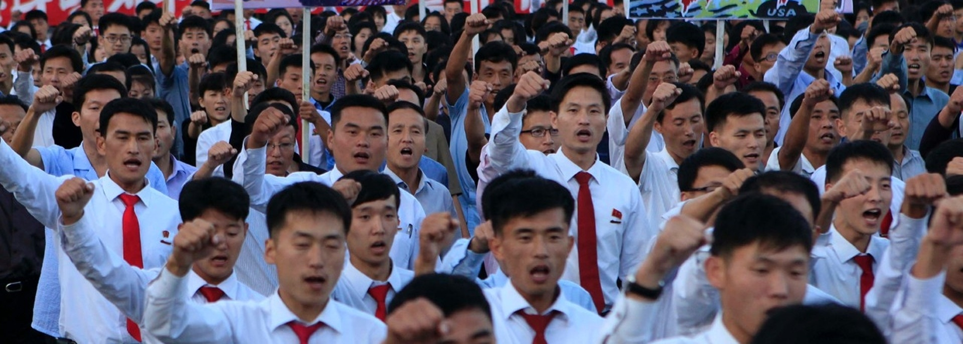 "DELETES NUMBER OF PEOPLE - North Koreans gather at Kim Il Sung Square to attend a mass rally against America on Saturday, Sept. 23, 2017, in Pyongyang, North Korea, a day after the country's leader issued a rare statement attacking Donald Trump. The sign on the left reads ""decisive revenge"" and the sign on the right reads ""death to the American imperialists."" (AP Photo/Jon Chol Jin)"