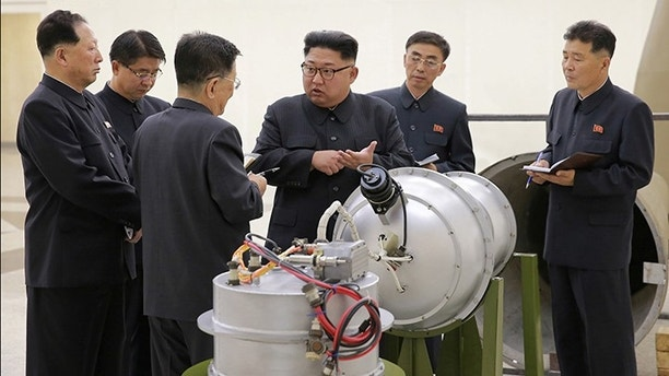 North Korean leader Kim Jong Un provides guidance with Ri Hong Sop (3rd L) and Hong Sung Mu (L) on a nuclear weapons program in this undated photo released by North Korea's Korean Central News Agency (KCNA) in Pyongyang September 3, 2017.  KCNA via REUTERS    ATTENTION EDITORS - THIS PICTURE WAS PROVIDED BY A THIRD PARTY. REUTERS IS UNABLE TO INDEPENDENTLY VERIFY THE AUTHENTICITY, CONTENT, LOCATION OR DATE OF THIS IMAGE.  NOT FOR SALE FOR MARKETING OR ADVERTISING CAMPAIGNS. NO THIRD PARTY SALES. NOT FOR USE BY REUTERS THIRD PARTY DISTRIBUTORS. SOUTH KOREA OUT. NO COMMERCIAL OR EDITORIAL SALES IN SOUTH KOREA. THIS PICTURE IS DISTRIBUTED EXACTLY AS RECEIVED BY REUTERS, AS A SERVICE TO CLIENTS.     TPX IMAGES OF THE DAY - RC11A4474900
