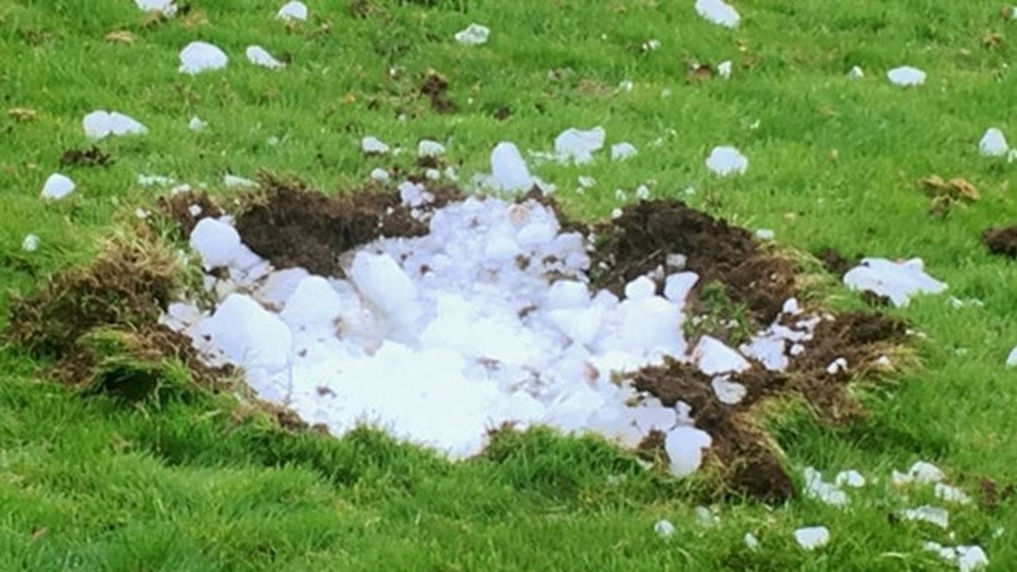 A Scottish family claims this block of ice fell out of the sky and landed in their garden.