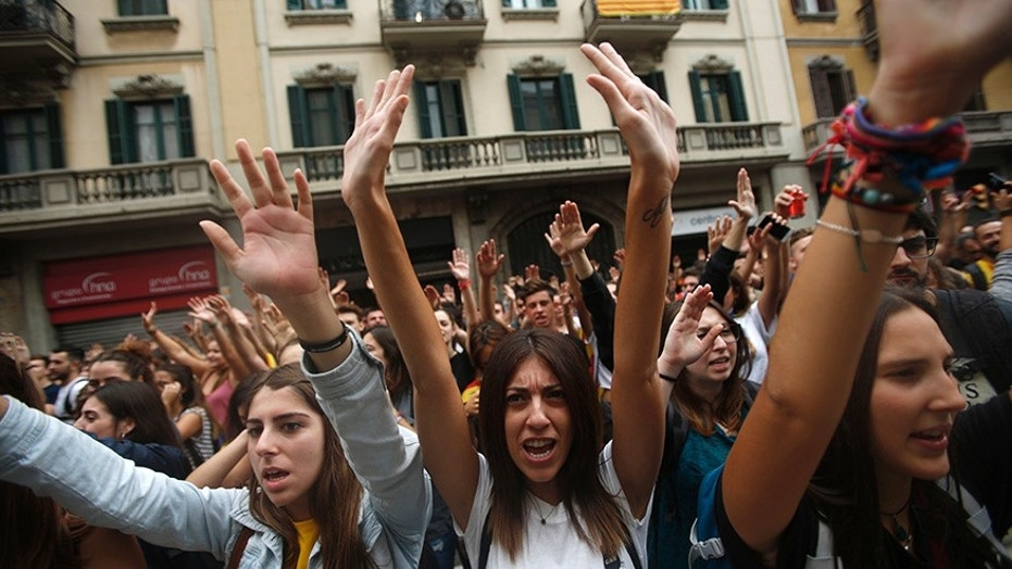 Labor unions and grassroots pro-independence groups are urging workers to hold partial or full-day strikes throughout Catalonia to protest alleged brutality by police during a referendum on the region's secession from Spain that left hundreds of people injured.