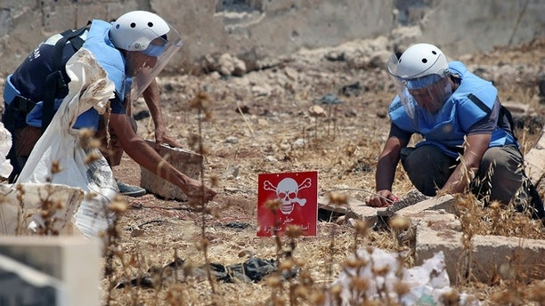 Civil defense members prepare to safely detonate cluster bombs in the rebel-held area in Deraa, Syria July 26, 2017. Picture taken July 26, 2017.  REUTERS/Alaa al-Faqir - RC1836418E70