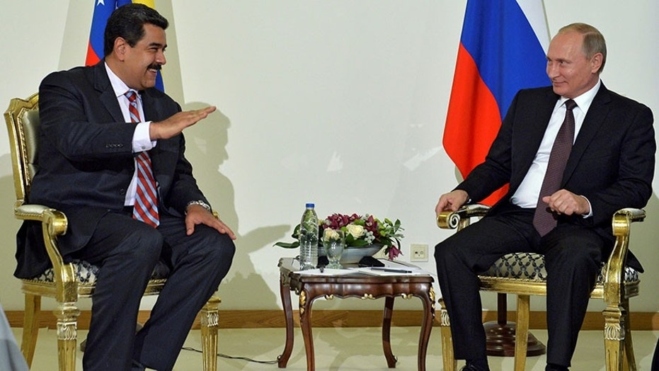 Venezuelan President Nicolas Maduro, left, and Russian President Vladimir Putin meet in Istanbul, Turkey, Oct. 10, 2016.