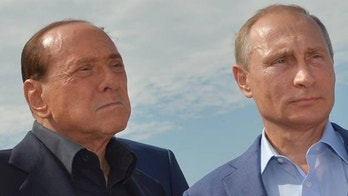 Russian President Vladimir Putin, right, and former Italian Prime Minister Silvio Berlusconi visit a memorial to the soldiers from Sardinia killed in the Crimean War, near Mount Gasfort outside Sevastopol in Crimea, Friday, Sept. 11, 2015. (Alexei Druzhinin/RIA-Novosti, Kremlin Pool Photo via AP)