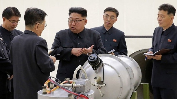 North Korean government shows North Korean leader Kim Jong Un center at an undisclosed location in North Korea. The world is wondering if North Korea's next nuclear test will involve a nuclear missi