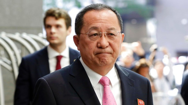 "FILE - In this Sept. 25, 2017 file photo, North Korea's Foreign Minister Ri Yong Ho speaks outside the U.N. Plaza Hotel, in New York. Russian state news agency Tass says North Korea's foreign minister has described his nation's nuclear weapons as a ""sword of justice."" Tass quoted North Korean Foreign Minister Ri Yong Ho accusing U.S. President Donald Trump of ""setting a fuse of war"" with his September speech at the United Nations, it was reported on Wednesday, Oct. 11, 2017. (AP Photo/Richard Drew, File)"
