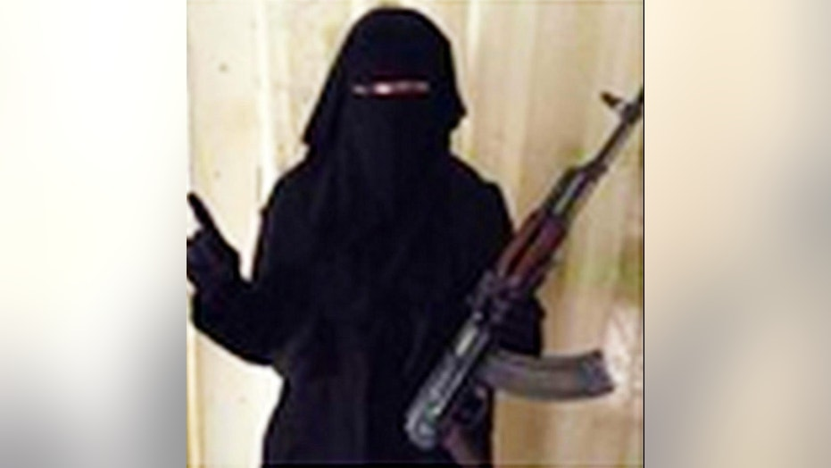 An alleged photograph of Jones in an Islamic veil and holding AK-47.  (Twitter)
