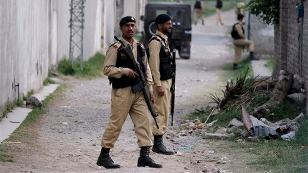 May 5: Pakistani army troops guard the perimeter of the walled compound of a house where al-Qaida leader Osama bin Laden was caught and killed by U.S. forces in Abbottabad, Pakistan.