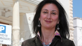 Maltese investigative journalist Daphne Caruana Galizia poses outside the Libyan Embassy in Valletta April 6, 2011. Investigative journalist Caruana Galizia was killed after a powerful bomb blew up a car killing her in Bidnija, Malta, in October 16, 2017. Picture taken April 6, 2011. REUTERS/Darrin Zammit Lupi - RC11D8CC39E0