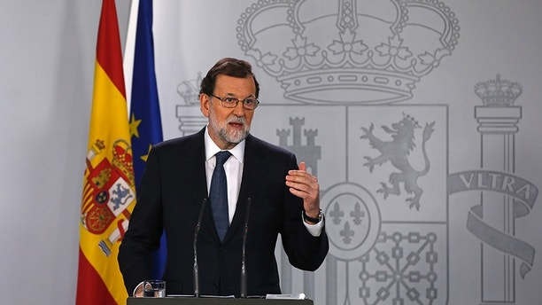 Spain's Prime Minister Mariano Rajoy gestures as he speaks during a press conference at the Moncloa Palace in Madrid, Spain, Wednesday, Oct. 11, 2017. The Spanish Cabinet met in Madrid Wednesday to work out its response to an announcement from the head of the wealthy Catalonia region that he was proceeding with a declaration of independence, further fueling Spain's worst political crisis in decades. (AP Photo/Paul White)