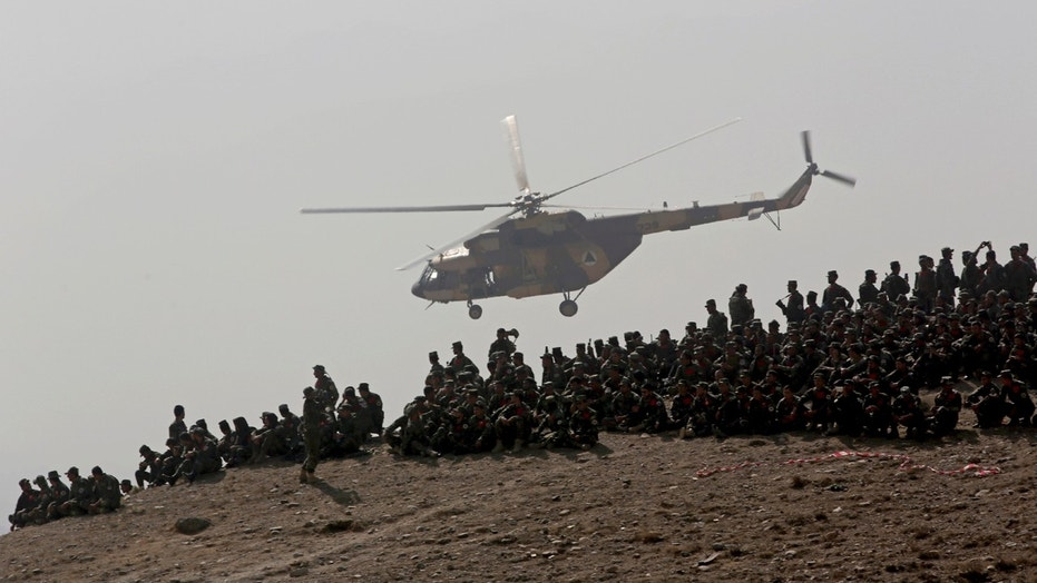 Afghan National Army soldiers watch during a military exercise in Kabul.
