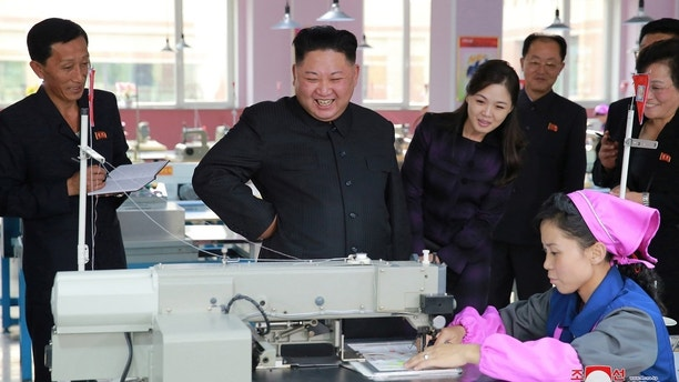 North Korean leader Kim Jong-Un, together with his wife Ri Sol Ju (centre R), visit Ryuwon Footwear Factory in this undated photo released by North Korea's Korean Central News Agency (KCNA) in Pyongyang on October 19, 2017. KCNA/via REUTERS    ATTENTION EDITORS - THIS IMAGE WAS PROVIDED BY A THIRD PARTY. REUTERS IS UNABLE TO INDEPENDENTLY VERIFY THIS IMAGE. NO THIRD PARTY SALES. SOUTH KOREA OUT. NO RESALES. NO ARCHIVES - RC1FBC26C3B0