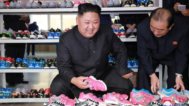 North Korean leader Kim Jong-Un visits Ryuwon Footwear Factory in this undated photo released by North Korea's Korean Central News Agency (KCNA) in Pyongyang on October 19, 2017. KCNA/via REUTERS    ATTENTION EDITORS - THIS IMAGE WAS PROVIDED BY A THIRD PARTY. REUTERS IS UNABLE TO INDEPENDENTLY VERIFY THIS IMAGE. NO THIRD PARTY SALES. SOUTH KOREA OUT. NO RESALES. NO ARCHIVES - RC1987B40890