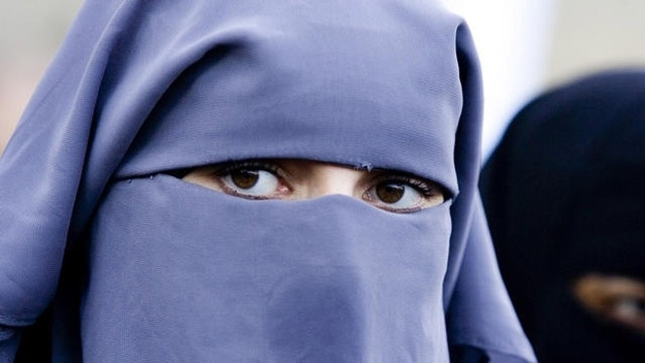 Unidentified women wearing a niqab during a protest outside the Dutch parliament against a proposed ban on the burqa, the head-to-toe Islamic robe, in the Hague, Netherlands, Nov. 30, 2006.