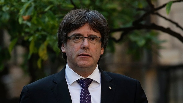 Catalan President Carles Puigdemont arrives for a meeting at the Palau Generalitat in Barcelona, Spain, Tuesday, Oct. 17, 2017. Spain's confrontation with its independence-seeking region of Catalonia intensified Monday when a judge ordered the leaders of two pro-independence groups jailed while they are investigated on possible sedition charges for organizing demonstrations before the region's disputed secession vote. (AP Photo/Manu Fernandez)