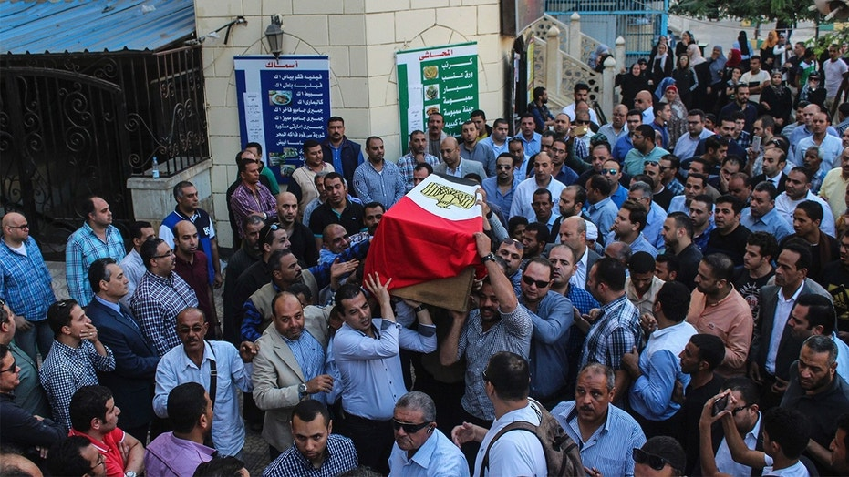 People carry the coffin of Egyptian police officer, Ahmed Fayez who killed a day earlier in a shoot-out with suspected militants south-west of Cairo, during his funeral procession at El Hosary Mosque in Sixth of October city, 15km from Cairo, Egypt.