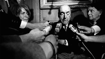 FILE - This Oct. 21, 1971 file photo shows Pablo Neruda, poet and then Chilean ambassador to France, talking with reporters in Paris after being named the 1971 Nobel Prize for Literature. National and foreign experts announced Friday, Oct. 20, 2017, that the Nobel Prize-winning poet did not die of cancer, rejecting the official version. (AP Photo/Laurent Rebours, File)